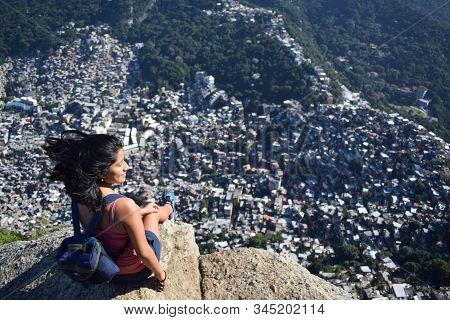Amazing Image Of A Latina Woman Watching A Favela In Rio De Janeiro, Brazil