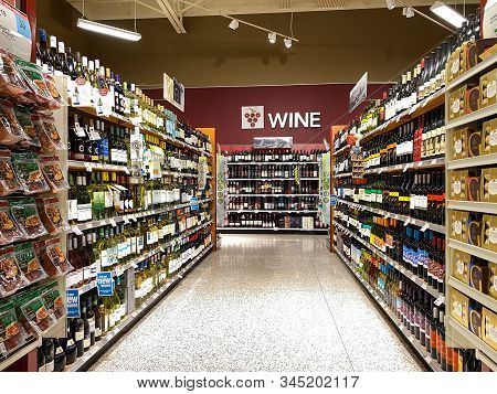 Orlando,fl/usa -1/15/20:  The Wine Aisle Of A Grocery Store With A Variety Of Wines From Various Man