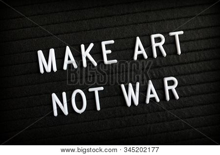 The Phrase Make Art Not War In White Letters On A Notice Board As A Message Of Peace