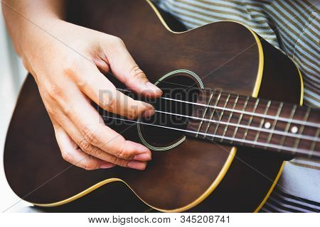 Closeup Of Guitarist Hand Playing Guitar. Musical Instrument Concept. Outdoors And Leisure Theme. Se