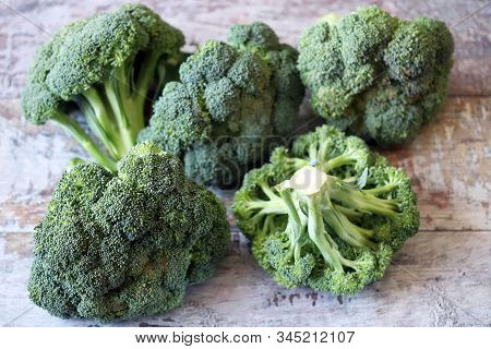Raw Broccoli Heads. Raw Broccoli. Harvest Broccoli. Selective Focus. Macro.