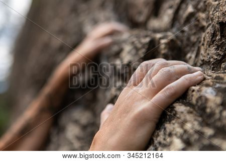 A Closeup View Of Fingertips Attempting To Hold On To A Limestone Cliff, Trying, Failing And Retryin