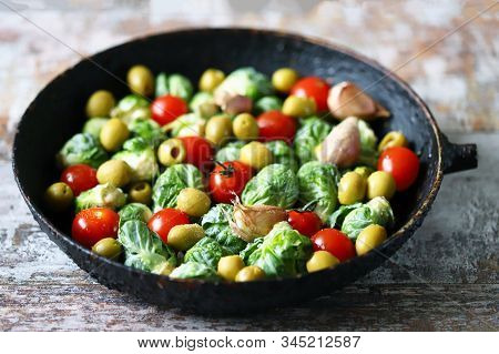 Brussels Sprouts With Vegetables And Herbs In A Pan. Cooking Brussels Sprouts. Vega Food. Selective