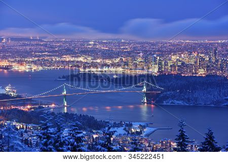 Lions Gate Bridge And Downtown Vancouver In Winter With Snow