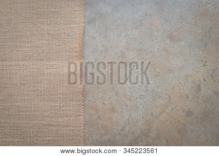 Background, Sackcloth, On A Concrete Floor Covered With Different Beige Scales And Eyebrows, Sackclo