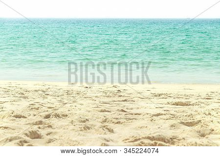 Empty Sand Beach And Tropical Sea In Sunlight On Vacation Day