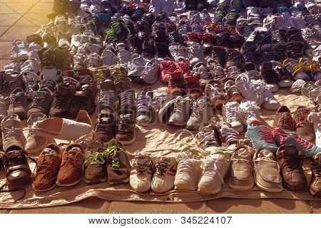Many Used Shoes On The Floor For Sale At Secondhand Market
