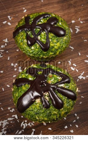 Homemade Fresh Muffins Baked With Wholemeal Flour With Spinach, Desiccated Coconut And Chocolate Gla