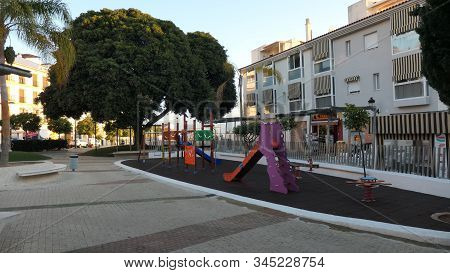 Alora, Spain - January 13, 2020: Slides And Climbing Equiment In Childrens Playground In Andalusian