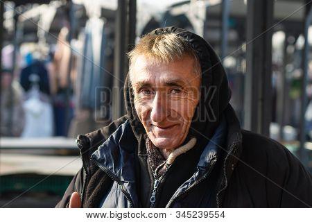 Belgrade, Serbia - 15.1.2020. Old Man Portrait On Market. Pensioner Lifestyle. Real Life Photo Of Ol