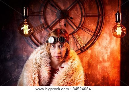Ugly Strange Girl In Unusual Glasses In A Strange Dark Room With A Clock On The Wall And The Light O