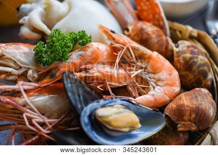 Cooked Steamer Food Served Seafood Buffet Concept / Fresh Shrimps Prawns Squid Mussels Spotted Babyl