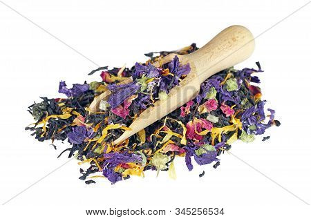Heap Of Tea Leaves And Flower Petals Isolated On A White. Blended Tea In A Scoop Close Up. Copy Spac