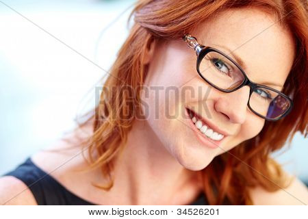 Close-up portrait of an elegant business lady wearing eyeglasses