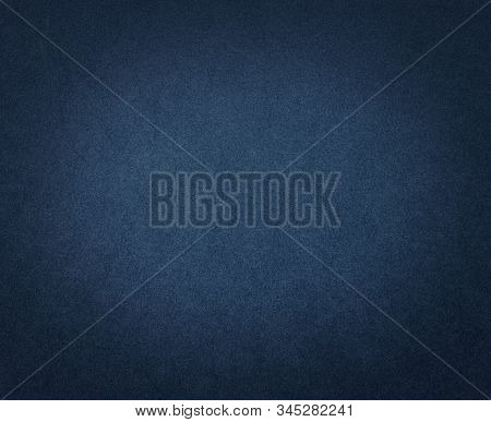 Dark Blue Paper Texture Or Background. Blue Cardboard With Dark Vignette.