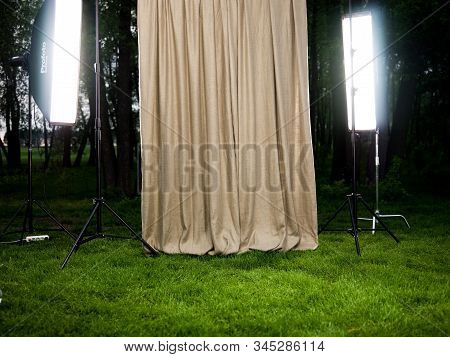 Grass And Trees Background With Studio Strobes And Stands Equipment