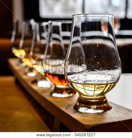 Scotch Whisky, Tasting Glasses With Variety Of Single Malts Or Blended Whiskey Spirits On Distillery