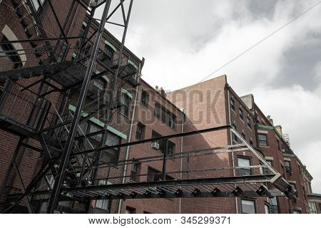 Cantilevered Fire Escape On Rear Of An Old City Apartment Building, Horizontal Aspect