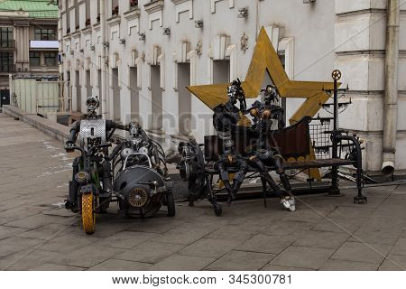 Moscow, Russia - January 7, 2020: Metal Sculpture. A Couple Kisses On A Bench Against The Background