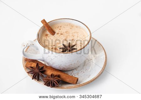 Indian Masala Chai Tea. Traditional Indian Hot Drink With Milk And Spices On White Background Close