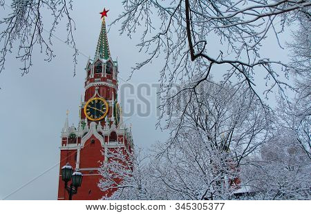 Beautiful View Of The Moscow Kremlin In Winter, Spasskaya Tower And Snow-covered Tree Branches