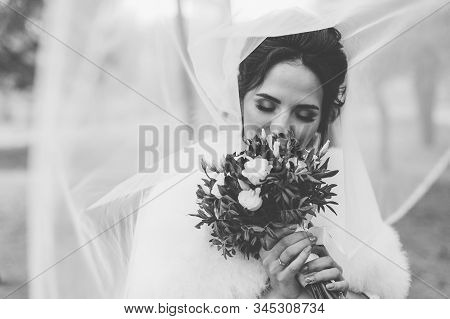 Happy Bride Under The Veil. Portrait Of A Bride On A Wedding Day.
