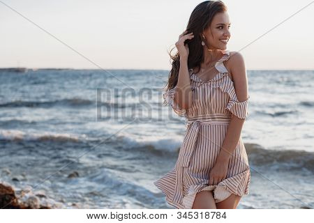 Beautiful Young Woman Posing Against The Sea And Skyline.summer Vacation Concept. Happy Woman Relaxi