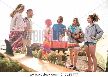 Hipster Friends Having Fun At Beach Camping Party - Wanderlust Travel Concept With Young People Trav