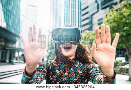 Young Asian Woman Experiencing Vr Glasses In Modern City - Virtual Reality And Wearable Tech Concept
