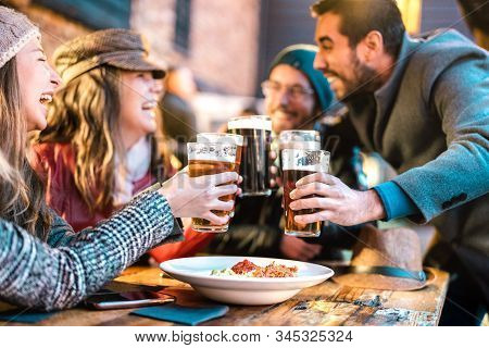Friendly Guys Approaching Happy Girls At Brewery Pub Outdoor On Winter Time - Friendship Concept Wit