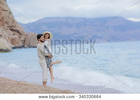 Happy Interracial Young Couple, Woman And Caucasian Man. Vacation Couple On Beach Together In Love.