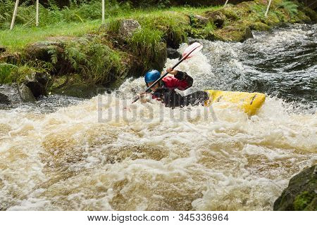 Frongoch Wales Uk - September 18 2016: Kayaker Paddling The Rapids At The National White Water Centr