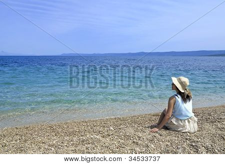 Girl on A Pebble Beach
