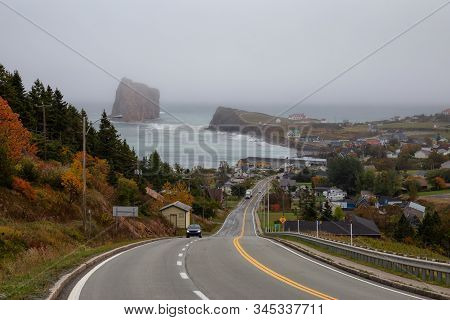 View Of A Road Leading To A Beautiful Modern Town On The Atlantic Ocean Coast During A Hazy Day. Tak