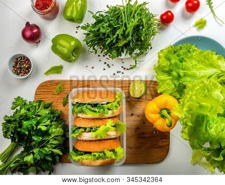 Big Burgers With Cutlet, Letuce, Cheese In Food Box. Top View. Close-up