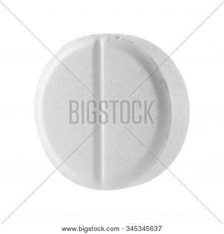 White Round Pill On A White Isolated Background. Big Pill Close-up.