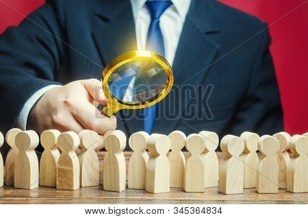 Man Studying A Crowd Of People With A Magnifying Glass. Market And Customers Research. Hr Search Can