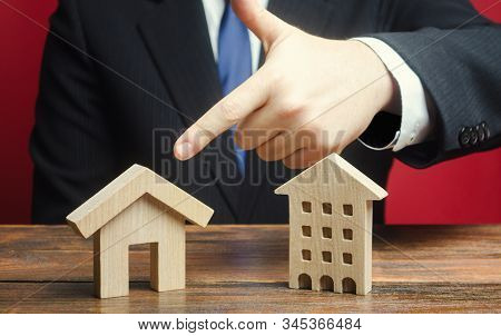 A Man Prefers To Choose A Private House Rather Than An Apartment Residential Building. Definition Fo