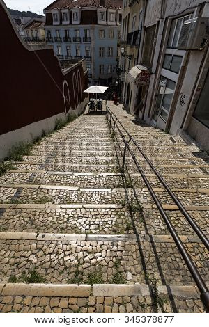 Lisbon - August 26, 2019: View Of One Of The Many Narrow Lanes In The Old Neighborhood Of Bairro Alt