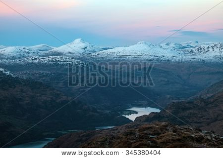 Evening View From The Summit Of Ben Lomond To The Neighboring Peaks And The Lake Loch Lomond At Suns