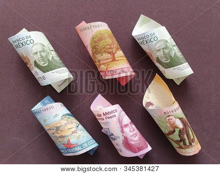 Costa Rican Banknotes And Mexican Bills Of Different Denominations