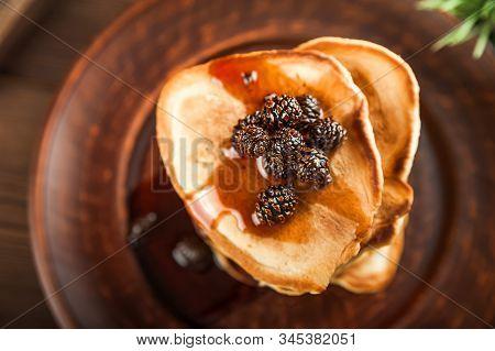 Siberian Dessert - Young Pine Cones Jam. Ukrainian Cone Jam In A Jar On A Dark Background Close-up A