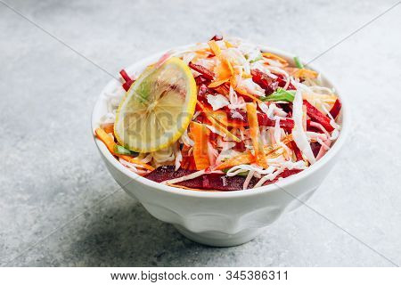 Spring Healthy Vegan Salad With Raw Beet, Carrot And Cabbage In White Bowls. Alkaline Diet Concept.