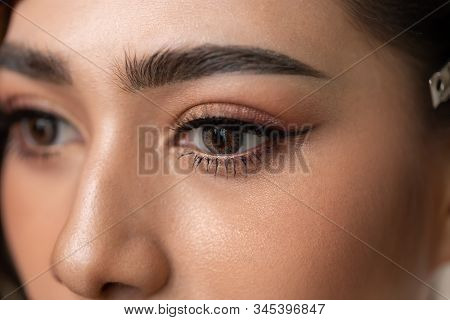 Close Up Beautiful Eyes Asian Woman With Contact Lens. Charming Beautiful Young Lady Get Brown Conta