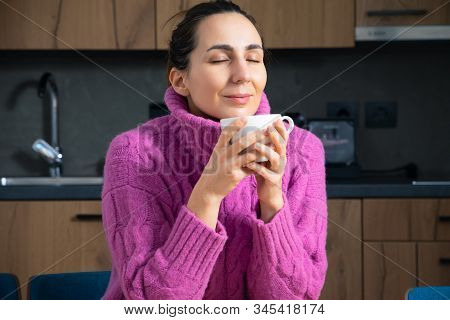 Beautiful Woman Relaxing With Coffee At Home. Woman Enjoying First Coffee At Home. Hipster Lifestyle