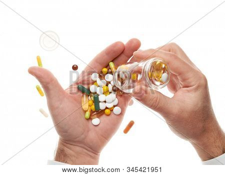 Man hand opening glass bottle full of pills, tablets, vitamins, drugs, capsules isolated on white background. White shirt, business style. Health care concept. Pharmaceutical industry. Pharmacy.