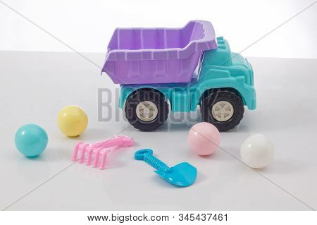 Colorful Toy Truck And Beach Toy Isolated On White Background