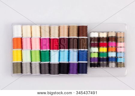 Colorful Of Cone Threads In Packaging Isolated On White Background