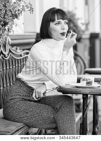 Pleasant Time And Relaxation. Delicious Gourmet Cake. Woman Attractive Brunette Eat Gourmet Cake Caf