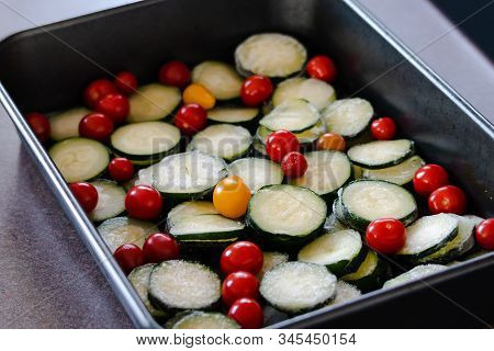 Healthy Meal-prepping Concept, Slices Of Zucchini And Cherry Tomatoes In Oven Tray Ready To Get Cook